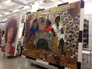 Art by Chuck Close and Mickalene Thomas in art storage during reinstallation.