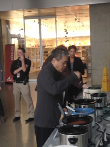 Director Mark Masuoka tasting the chili.