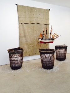 Radcliffe Bailey, To be Titled, 2012, tarp, iron, vintage model ship, wicker basket, and glass, 120 x 188 x 89 inches. Jack Shainman Gallery.