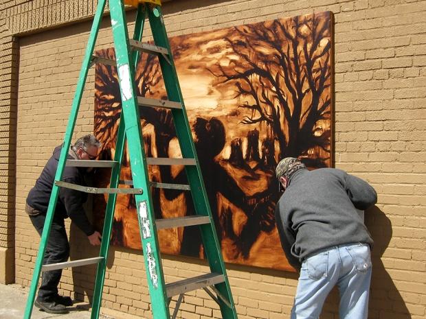 Bill and Denny of K-Lite Signs installing John Sokol's Man Eating Trees (reproduction)