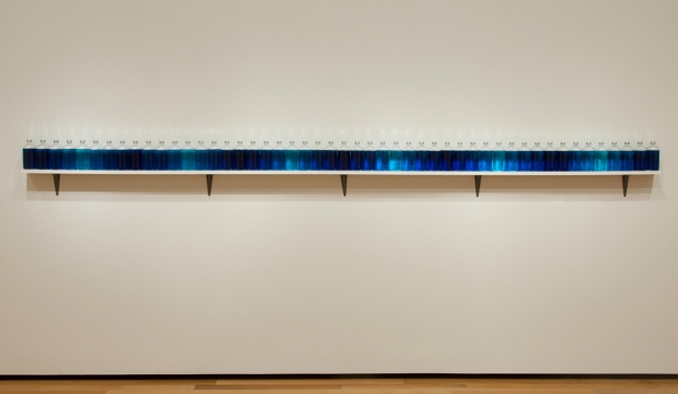 Tony Feher (Albuquerque, New Mexico, 1956 - ) Untitled, 2013 Glass bottles with aluminum screw caps, water, and food dye on painted wood shelf with metal brackets 12 3/4  x 144  x 3 1/2 in. (32.39  x 365.76  x 8.89 cm) The Mary S. and Louis S. Myers Endowment Fund for Painting and Sculpture
