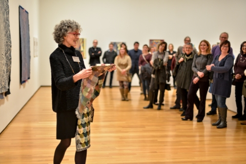 "Janice Lessman-Moss sharing the ""crayon-box"" during her talk at the NEO Geo opening reception. Photo: Shane Wynn."
